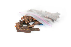 Beef Jerky with AirLock Bag. A studio angled close up shot of a plastic airlock bag containing homemade spicy beef jerky on a white background Royalty Free Stock Image