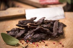 Beef Jerky. On wooden background Royalty Free Stock Photography