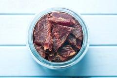 Beef jerky in jar Stock Image