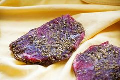 Beef jerky and spice on the table. Dried peppered beef jerky cut in strips. stock photography