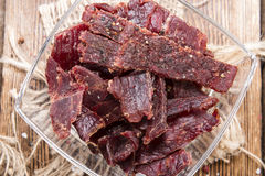 Beef Jerky on wooden background Stock Image