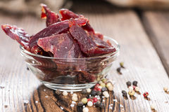Beef Jerky on wooden background Royalty Free Stock Images