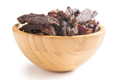 Beef jerky in wooden bowl Stock Photography
