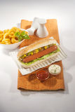 Beef Jumbo sausage sandwich with coleslaw & Ketchup & Fries Stock Images