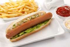 Beef Jumbo sausage sandwich with coleslaw & Ketchup & Fries Royalty Free Stock Photo