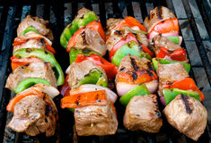 Beef kabobs and corn Stock Photos