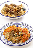 Beef kabsa meal with bowl vertical. A traditional Saudi Arabian or Gulf Arab meat kabsa meal, of rice, onion, carrots, capsicum, spices, and beef, served with a Stock Photos