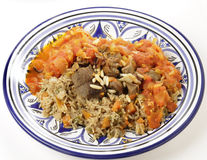 Beef kabsa meal with sauce. A traditional Saudi Arabian or Gulf Arab meat kabsa meal, of rice, onion, carrots, capsicum, spices, and beef, served with a homemade Royalty Free Stock Photo