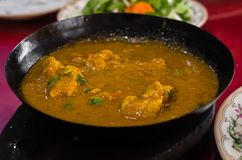 Beef Kadai. An indian delicacy served on a sizzling pan  on a blurry background Royalty Free Stock Photo