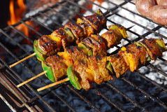 Barbecue beef kebabs on grill