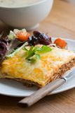 Beef lasagne. With rocket salad royalty free stock photo