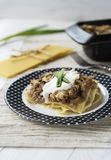 Beef Lasagne with mushrooms. Beef lasagne on a plate royalty free stock image
