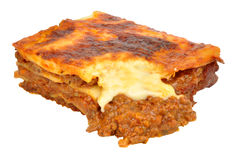 Beef Lasagne Portion. Portion of beef lasagne layered pasta isolated on a white background royalty free stock photo