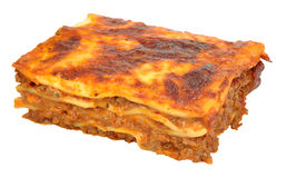 Beef Lasagne Portion. Portion of beef lasagne layered pasta isolated on a white background royalty free stock photography