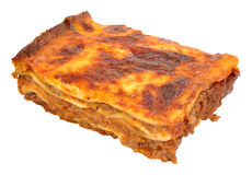 Beef Lasagne Portion. Portion of beef lasagne layered pasta isolated on a white background stock photography