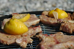 Beef with lemons on the grill Royalty Free Stock Images