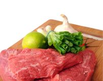 Beef, lime, onion, peppers, and garlic Stock Images