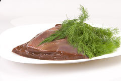 Beef liver with dill on white plate royalty free stock photography
