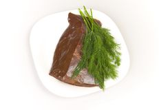 Beef liver with dill on white plate Royalty Free Stock Image
