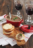 Beef liver pate on bread. And glasses of wine Stock Photography