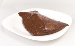 Beef liver on white plate stock photography