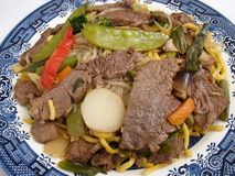 Beef Lo Mein. Photo of popular Chinese food called beef lo mein. This dish is made with noodles, beef, water chestnuts, red pepper, mushrooms, broccoli, carrots royalty free stock photos