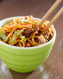 Beef lo mein in a bowl with chopsticks Royalty Free Stock Image