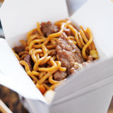 Beef lo mein in take out box. Shot close up Royalty Free Stock Image