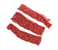 Beef loin sirloin grilling tips on a white background. Top view of three raw beef loin sirloin grilling tips isolated on a white background Stock Photography
