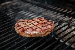 Beef Loin Top Sirloin Steak Cooking on the Grill stock photo