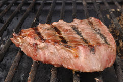 Beef Loin Top Sirloin Steak on the Grill. Beef Loin Top Sirloin Steak Cooking on the Grill Stock Photography