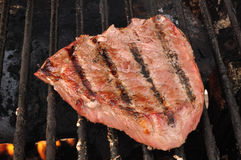 Beef Loin Top Sirloin Steak on the Grill. Beef Loin Top Sirloin Steak Cooking on the Grill Royalty Free Stock Photography