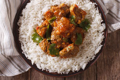 Beef madras with basmati rice close-up on a plate. horizontal to. Traditional beef madras with basmati rice close-up on a plate. horizontal view from above Royalty Free Stock Photo