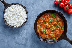 Beef Madras curry slow cook Indian spicy chili butter lamb food with rice Royalty Free Stock Photo