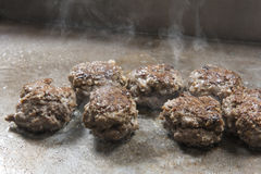Beef meat balls cooking on grill at at restaurant buffet Royalty Free Stock Photos