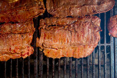 Beef meat barbecue grilled with embers and smoke Stock Photography
