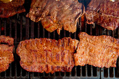 Beef meat barbecue grilled with embers and smoke Stock Image