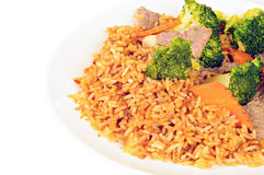 Beef meat, broccoli, carrots and rice with soy sauce on white pl Stock Photos