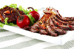 Beef meat on ceramic plate Royalty Free Stock Photography