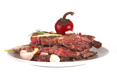 Beef meat chunk on grey dish Stock Photos