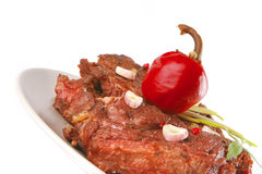 Beef meat chunk on grey dish Stock Photography
