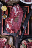 Beef meat on a cutting board. Raw beef meat on a cutting board Stock Photos