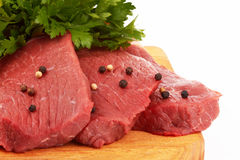 Beef meat. Fresh raw beef meat slices over a wooden board Stock Image