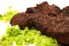 Beef meat and green salad over white Royalty Free Stock Photo