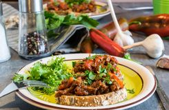 Beef meat mixture with tomatoes and pepper on fried bread, herbaceous. Great dinner Royalty Free Stock Photography