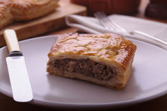 Meat Pasty. Beef meat Pasty on a plate with knife and fork Stock Images