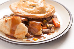 Beef meat pie. Meat pie made with roast beef in a savoury gravy Stock Photography