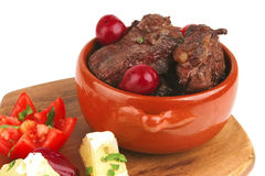 Beef meat in pot with vegetables Stock Images