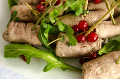 Beef meat roll with arugula and red currant Royalty Free Stock Image