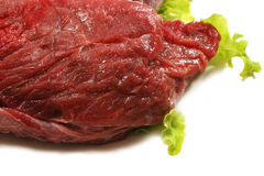 Beef meat and salad over white. Raw beef meat and salad over white Stock Photos